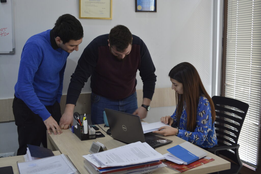 03 sales executive anton shavtvaishvili and sales manager alexi gagoshidze discuss ongoing projects with tech engineering groups director irine gloveli
