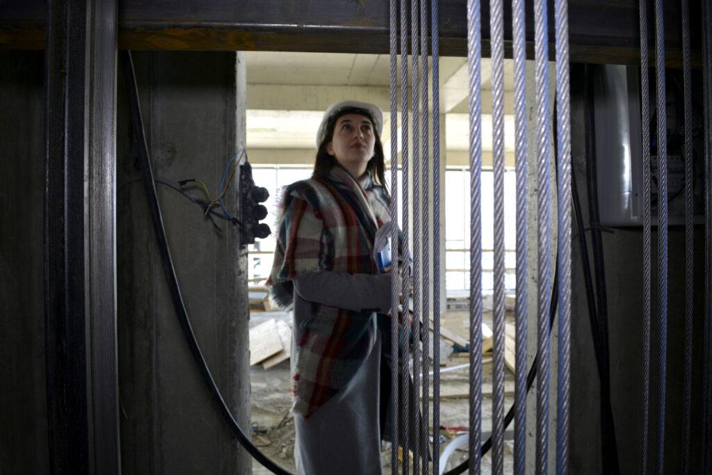 09 director of techengineeringgroup irine gloveli checks the elevator shaft engineered by her team