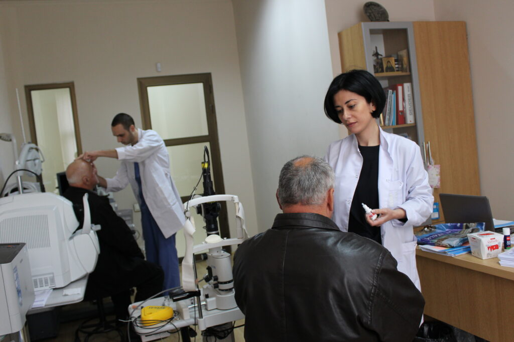 tekla mamageishvili and her assistant examining patients